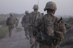 U.S. Marines with Company A, 1st  Battalion, 5th Marine Regiment, conduct a security patrol in Nawa District, Helmand Province, Afghanistan, on Aug. 20, 2009.  1st Battalion, 5th Marine Regiment, is deployed with Regimental Combat Team 3, whose mission is to conduct counter insurgency operations in partnership with the Afghan national security forces in southern Afghanistan.  (U.S. Marine Corps photo by Lance Cpl. Phillip Elgie/Released)