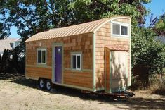 Wow! Beautiful and unique tiny house with amazing decor. lilypad-tiny-house-on-wheels-002