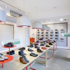 London designer Tomás Alonso used ceramic tiles to create optical illusions in this store he designed for Spanish shoe brand Camper in London. The interior is lined with a grid of white 10 by 10cm tiles, but this pattern is broken in places by coloured geometric tiles to create the illusion of recesses or volumes …