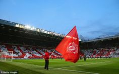A flag bearer waves the club crest before the Champions League Quarter Final against Bayern in 2014
