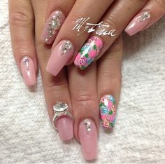 Light pink nails with diamonds and a special touch of floral flowers