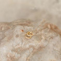 Description Our best selling signature huggie is the perfect addition when layering or having a simple look all on its own. Inspired by the sparkling waters and lights of majestic Santorini. Details 18K double layered gold, crystal encrusted over sterling silver Measurements size: 15mm; inner diameter 8.5mm thickness: 2mm weight: 0.075oz closure: lever back Santorini, Sparkling Waters, Layering, Sparkle, Stud Earrings, Lights, Inspired, Sterling Silver, Outfits
