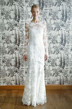 Long sleeved lace wedding dress in simple style