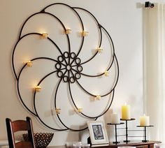 wheelhouse wall-mount candleholder  $200 (possibly paint and hang a half moon/sun in the center)
