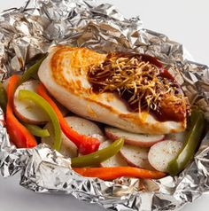Talk about perfect picnic food. Fill a cooler with these handy BBQ Chicken and Cheddar Foil Packet Dinners and pop them on the grill for an easy lunch or dinner. There's no clean up!