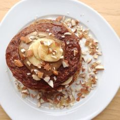 curlsnchard: After quite some time, some #vegan #pancakeporn for you guys! I made half of the #pancakes with #cacao powder, half plain and stacked it with sliced banana. Chopped almonds, tahini and a little bit of pure maple syrup on top - my personal definition of pancake-perfection ☺️ There's a new post #ontheblog as well, and a question for you guys as well! So please go check it out, link is in my bio #blogilates #thekitchn #breakfastcriminals #conniesharethelove #breakfast #frühstück…