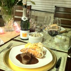 Surf and turf - Filet Mignon with red wine sauce and baked lobster with lemon butter. Served with a side of mushroom risotto. Special dinner at home :)