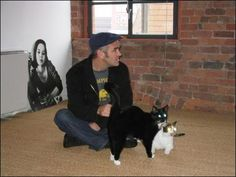 Morrissey and glowy-eyed cats