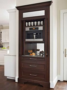 A tall walnut cabinet with pocket doors makes an attractive place to store the coffee station. A built-in Miele coffee maker and a mirrored back panel makes the cabinetry pretty to look at even when the doors are open. Source: BH&G Coffee Station Kitchen, Coffee Bars In Kitchen, Home Coffee Stations, Beverage Stations, Layout Design, Built In Coffee Maker, Coffee Nook, Coffee Coffee, Coffee Plant