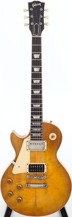 1959 Gibson Les Paul Standard Sunburst Left-Handed Solid Body Electric Guitar, Serial # 9 0136. This is undoubtedly the same guitar pictured with John McEnroe on the cover of the Guitar Aficionado, Vol. 1/No. 4. Sold for $194,500.00, Heritage Auctions 2012 October 27 Vintage Guitars & Musical Instruments Signature Auction - Beverly Hills #7071