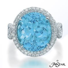 A 10.03 cts. oval-shape paraiba is decorated with micropave diamonds in this platinum cocktail ring.      JB Star