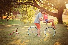 Maternity, Pregnancy Picture Announcement - Kiss on bike with tricycle - Golden sunset