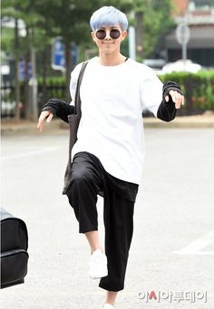 RM doing some yoga or martial art stance on the street