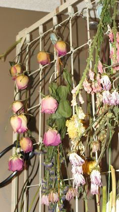Drying flowers hang perfectly on repurposed baby bed spring.