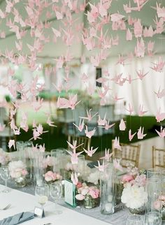 Origami is a very romantic trend that has appeared in the recent years and has already become super popular. Making cute paper cranes unites the guests and relatives even before the wedding, and such hangings and chandeliers...