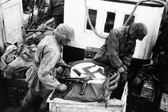 To alert their own airforce to their presence, soldiers spread the Swastika across boats used by the S.S. troops to cross the Gulf of Corinth, Greece, on May 23, 1941.