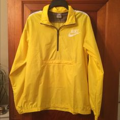 Nike Windbreaker Excellent condition Nike Windbreaker in vibrant yellow with brown and white. Pullover style with front zip pocket. Size medium I am guessing men's. Would fit ladies large and X-large. These are all the rage right now! Nike Jackets & Coats