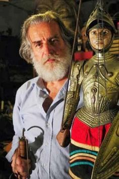 """Mimmo Cuticchio, the most famous """"oprante"""" (a person who owns and directs a Pupi theatre) and """"puparo"""" in the world.  He continued the tradition of his grandfather and father, founding the """"Associazione Figli d'Arte Cuticchio"""" to keep this world alive."""