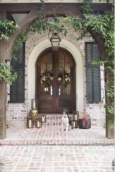 Front door ideas and design to add curb appeal for new house, renovation, new build, or remodel: brick front porch with arched wood stain french front doors Style At Home, Future House, My Dream Home, Exterior Design, Colonial Exterior, Colonial Front Door, French Country Exterior, Cottage Exterior, French Country House