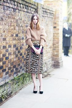 Tan knit tucked into a leopard print midi skirt. // #StreetStyle