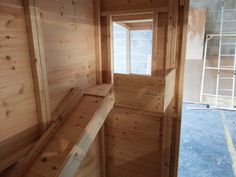 Inside a rabbit shed with a shelf and balcony