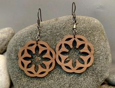 Unique earrings with Celtic floral shape made from wood. Natural handcrafted gift for ordinary use or special occasions. Ornate, symbolic, and enchanting, Celtic jewelry was highly coveted. Celtic jewelry were so sought after for their beauty and style that the trade of Celtic jewelry