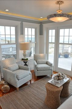 Dream Beach Cottage with Neutral Coastal Decor Living room - coastal inspired - not overly beach themed or nautical - double tables instead of single coffee table Home, House Styles, Beach House Decor, Sunroom Designs, Coastal Living Rooms, House, Coastal Interiors, House Interior, Luxury Homes