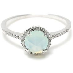 Mint opal. Gorgeous.  I've always wanted an opal engagement ring, and never thought of one like this. Normally I'd want one with more fire, but this is really pretty, and totally one of my best colors! :D
