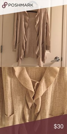 Ruffle front cardigan Oatmeal colored ruffle front open cardigan. Has inside tie option if want to wear closed. (See picture #2). Oversized with 2 front pockets. Super soft and really cute! Listed as tan, but color is technically oatmeal. H&M Sweaters Cardigans