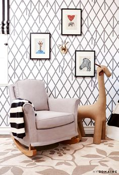 A patterned reading nook with animal prints and striped blanket on rocking chair