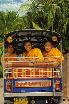 Buddhist Monks Sharing Tuk-Tuk in Bangkok.