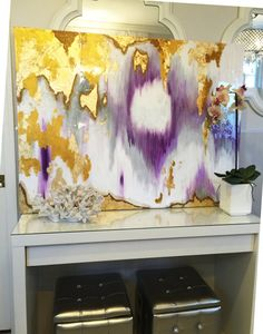 Gold and Gray artwork in white and silver bathroom with chandelier. Gold leaf art with high gloss shine