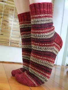 Just a little more complex than the basic stockinette sock, Cranberry Biscotti alternates three colours in a Woven Stripe slip-stitch pattern. Also included is a delicious recipe for Cranberry Chocolate Biscotti.