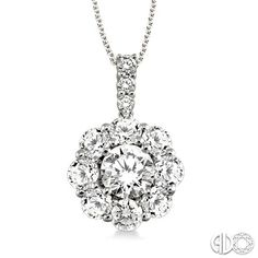"Round cut diamond pendant in antique style ""daisy cluster"" setting in 14k white gold. 2 carat total weight. #diamond #diamonds #necklace"