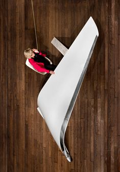 designed by les ateliers flown, the 'cantilevered desk' is a unique furniture piece derived from the winglet of a rare boeing 737-800 aircraft.