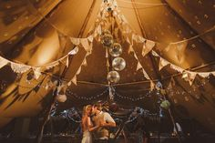 Bunting and disco balls above the dance floor - looks amazing!