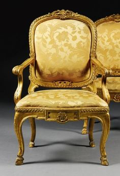 A pair of Italian carved giltwood armchairs, Rome, circa 1770 each with a cartouche shaped padded back with a foliate carved cresting within a guilloche carved frame above downscrolled arms and serpentine drop-in padded seat, the seat-rail centred by a raised tablet enclosing a patera on cabriole legs terminating in hoof feet. Most probably from Palazzo Borghese or Villa Borghese, Rome. Possibly the pair formerly in the collection of Principe Don Gerolamo Rospigliosi.
