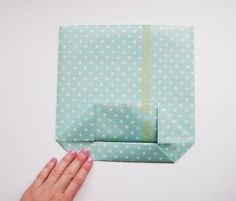 Paper gift bag tutorial... now I know what to do with all the scrapbook paper I have lying around.