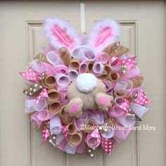 This adorable Easter bunny wreath will be perfect for your door this Spring! This wreath measures 24 in diameter with a depth of 8. It is constructed out of metallic white and pink deco mesh and burlap deco mesh. It is adorned with pink and tan polka dot ribbons. In the center is a burlap bunny butt. The fuzzy bunny ears at the top give the wreath a fun and whimsical look! Ready to ship with free shipping! Check out our other wreaths here: http://www.welcomingwreathsandmore.etsy....