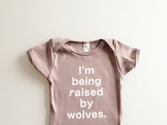 Baby one piece I'm Being Raised By Wolves babies by eggagogo Cute Kids, Cute Babies, Baby Kids, Baby Boy, Raised By Wolves, After Baby, First Time Moms, Baby Sleep, Baby Fever