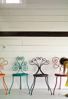 I like the idea of buying metal chairs and spray painting them fun colors... I'm sure you could do the same with a bench.  This way you could get all different ones :)