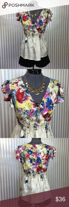 """""""Heartsease Habotai Blouse"""" by Edme & Esyllte Beautiful 100% silk blouse. Lightweight silk forms a deep V-neck speckled with fading flowers. Cream color with purple, blue, red, & yellow flowers. Flutter sleeves. Elastic waist. Size 2, True To Size. Back of neck to hem is approx. 23 inches. In perfect condition. Anthropologie Tops Blouses"""