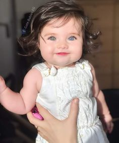 e522b303c84d dark hair and blue eyes! This little girl is beautiful!!