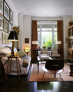 """House & Home editor Suzanne Dimma added a vintage globe light to her living room. She notes, """"The antique globe was in my dad's library when I was a kid, and he let me have it when I moved in. I love the way it casts a soft glow in the room."""" Source"""