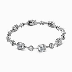 This delicate vintage-style bracelet is accentuated by 2.19 ctw round cut white diamonds and 1.32 ctw baguette cut diamonds in a lovely white gold setting. Print Page
