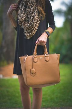 Flowy navy dress with leopard print scarf and brown bag