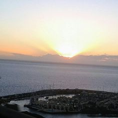 #sunset #sun #clouds #sea #puertomogan #water #sky - @rubenl3- #webstagram