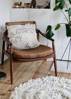 Crazy cushion of love knitting kit by Wool and the Gang. Give away! Tan leather armchair in mid century design.