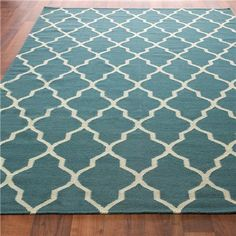 Quatrefoil rug.  5x8 is $299.00 Many other sizes are available.  Available in multiple colors: green, orange, teal, brown, sky blue.
