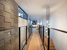 Desire to Inspire ideas. Glass, wood, and metal staircase with textured wall.